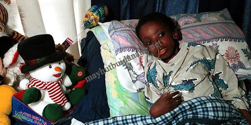 Sức khỏe Nkosi Johnson yếu dần sau khi trở về từ Mỹ